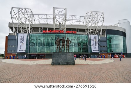 MANCHESTER, ENGLAND - September 6, 2014: Old Trafford stadium is home to Manchester United one of the wealthiest and most widely supported football teams in the world. - stock photo