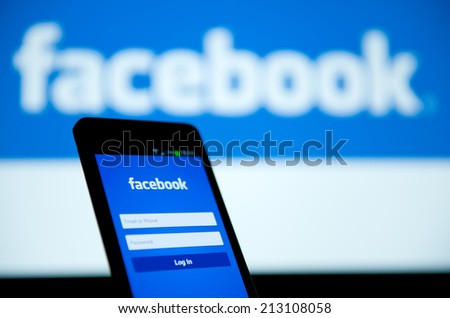 MANCHESTER - FEB 12: Facebook Sign in page on mobile phone on Feb. 12 2014 in Manchester, UK. More than 425 million active users access Facebook through mobile devices in 60 countries. - stock photo