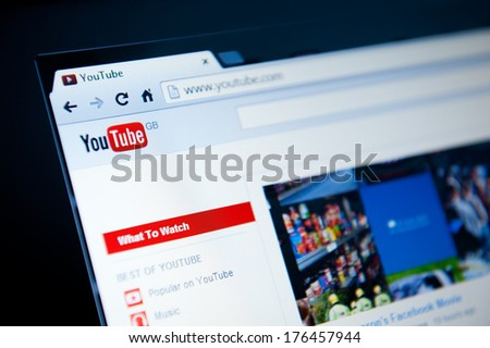 MANCHESTER - FEB 13: YouTube GB website home page on Feb 13, 2014 in Manchester, UK. YouTube is a video-sharing website, created by three former PayPal employees and owned by Google since late 2006. - stock photo