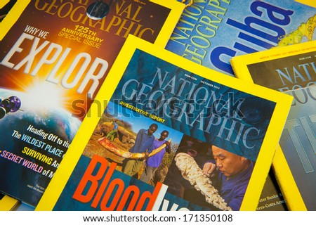 MANCHESTER - JAN 15: Collection of National Geographic Magazines on Jan. 15, 2014 in Manchester, UK. National Geographic Magazine has been published continuously since its first issue in October 1888. - stock photo