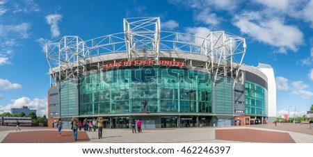 MANCHESTER - MAY 22:  Panoramic view with perspective distortion of front side of Old Trafford Football stadium in Manchester city, England, was taken on May 22, 2016, under cloudy blue sky.