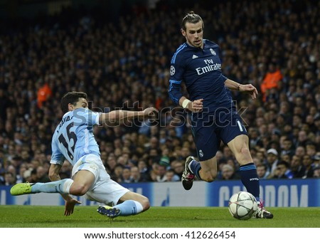 MANCHESTER, UK - APRIL 26, 2016: Gareth Bale and Jesus Navas pictured during UEFA Champions League semi-final game between Manchester City and Real Madrid at Etihad stadium. - stock photo