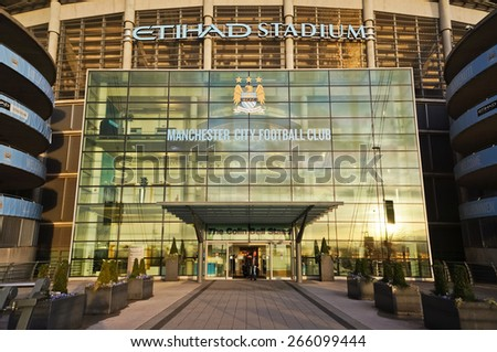 MANCHESTER, UK - FEBRUARY 10, 2014: The entrance of Etihad stadium in the evening light on February10, 2014 in Manchester, UK. Etihad stadium is home to Manchester City football club. - stock photo