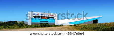 MANCHESTER, UK - JULY 19, 2016: The buildings are of an indoor skydiving tunnel company and behind the home to the UKs longest indoor skiing and indoor snowboarding slope - stock photo