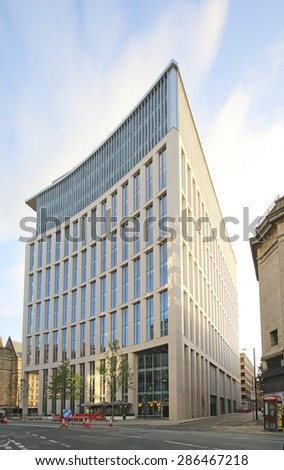 MANCHESTER, UK - JUNE 6, 2015: Office block. Manchester City Council hopes that Home will boost the economy by attracting other businesses to this part of the city centre. - stock photo