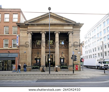 MANCHESTER, UK - MARCH, 25 2015: Facade of a Victorian commercial building which is now a restaurant/bar in the centre of Manchester, UK - stock photo