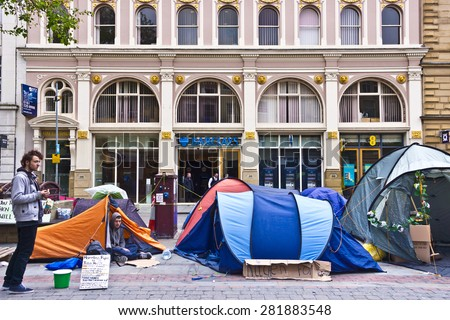 MANCHESTER, UK - MAY 27, 2015: The anti-cuts campaigners with their tents and sleeping bags at St Ann's Square in the centre of Manchester. - stock photo