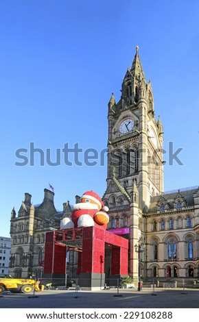 MANCHESTER, UK - NOVEMBER 5, 2014: Father Christmas being erected in front of Manchester Town Hall for the Christmas market and festivities - stock photo