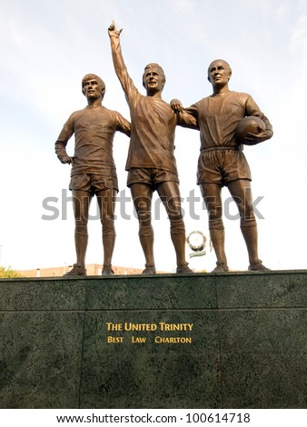 "MANCHESTER, UK - SEP 15: Statue of ""The United Trinity"" of George Best, Denis Law and Bobby Charlton, celebrating the 40th anniversary of Manchester United's first European Cup title. Sep 15, 2011. - stock photo"
