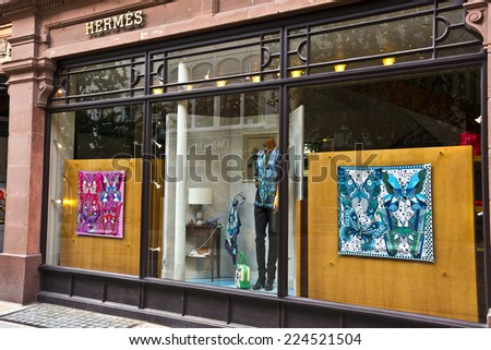 MANCHESTER, UK - SEPTEMBER 18, 2014: Window display of the Hermes French luxury goods boutique in the city centre.  - stock photo