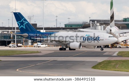 Manchester, United Kingdom - August 27, 2015: Air Transat Airbus A310 passenger plane taxiing on Manchester International Airport tarmac. - stock photo