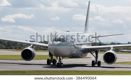 Manchester, United Kingdom - August 27, 2015: Qatar Airways Airbus A330 wide-body passenger plane taxiing after landing to Manchester International Airport.