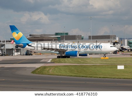 Manchester, United Kingdom - August 27, 2015: Thomas Cook Airbus A330 wide-body passenger plane taxiing on Manchester International Airport tarmac. - stock photo