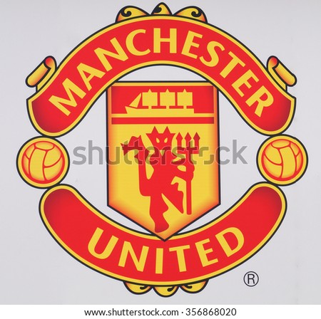 MANCHESTER, UNITED KINGDOM - 29 DECEMBER 2015: Manchester United Football Club crest painted on a wall outside their home stadium, Old Trafford. - stock photo