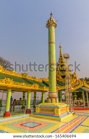 MANDALAY - FEBRUARY 25: Tourists visiting small temple with a column at the top of Sagaing hill on February 25, 2013 in Mandalay, Myanmar.