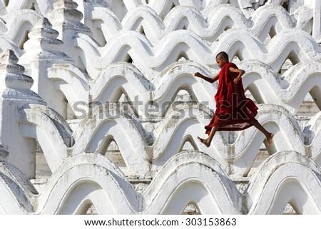 MANDALAY, MYANMAR- DEC 9 : Unidentified young Buddhism novice front temple at Hsinbyume pagoda temple on Dec 9, 2014 in Mandalay, Myanmar