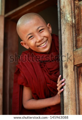 MANDALAY - MYANMAR - DECEMBER 8: An unidentified Burmese Buddhist novice on December 8, 2012 in Mandalay, Myanmar. In 2012 an ongoing conflict started between Buddhists and Muslims in Myanmar. - stock photo