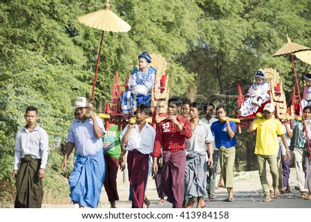 MANDALAY, MYANMAR - FEB 1: Boys ride on the carriage, shaded with gilded umbrellas and accompanied by a procession of family members in the novitiation ceremony on Feb 1, 2016 in Mandalay, Myanmar.