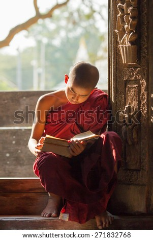 MANDALAY, MYANMAR - FEB 8, 2015: Undefined Asian neophyte read a book in a Buddihist temple on February 8, 2015 in Shwe-nandaw-kyaung temple, Mandalay, Myanmar. - stock photo
