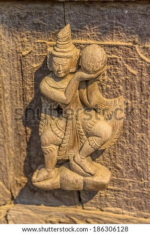 MANDALAY, MYANMAR - FEBRUARY 26, 2013: Wood carving at Shwenandaw Kyang Monastery. This is the only building that remains of the old Mandalay Palace which burnt down during World War II. - stock photo
