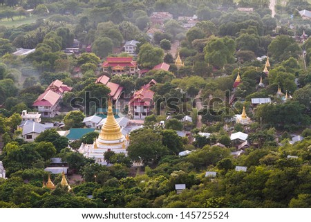 Mandalay with , temples and pagodas seen from mandalay hill at sunset, Burma - stock photo