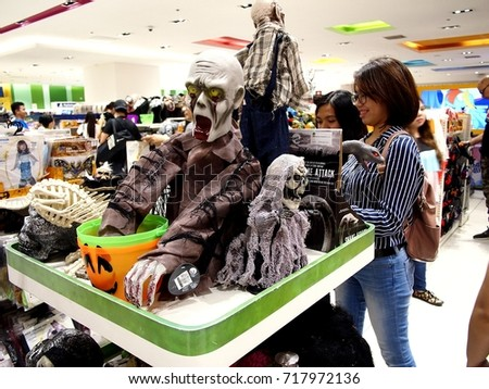 MANDALUYONG CITY, PHILIPPINES - SEPTEMBER 17, 2017: Halloween toys, masks, costumes and figurines on display at a toy store.