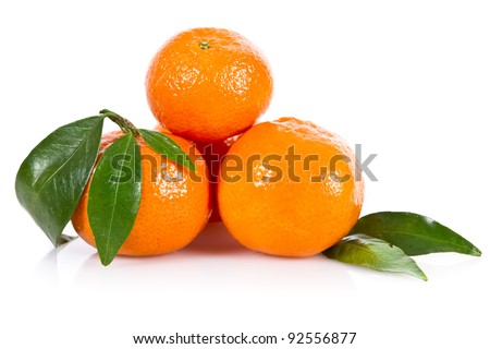 Mandarin fruits with leaves isolated over white - stock photo