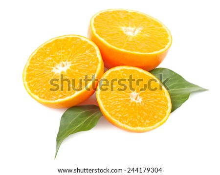 Mandarin orange slices with leaves on a white background