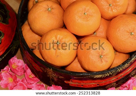 "Mandarin oranges are called""kam"" which means gold in chinese / Mandarin orange / Signifies wealth and prosperity - stock photo"