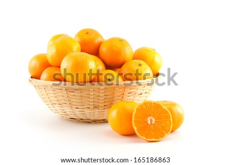 Mandarins in and out the basket on white background