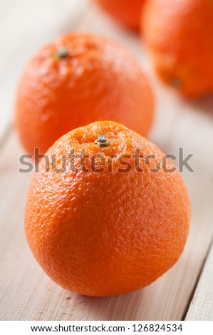 Mandarins on wooden boards, vertical shot, close-up