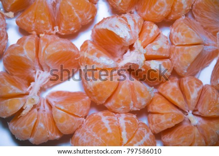 Mandarins without a skin on a white background. Peeled tangerines on white background.