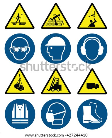 Mandatory construction manufacturing and engineering health and safety signs to current British Standards and hazard warning signs isolated on white background - stock photo