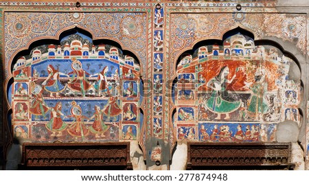 MANDAWA, INDIA - FEB 7: Fresco with Lord Krishna dancing in naive artistic style of Shekhawati region on February 7, 2015. With popul. of 21000, Mandawa is a touristic site with its art Havelis homes