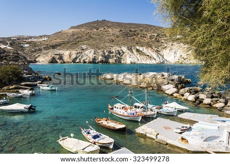 Mandrakia traditional Greek village with sirmate  - fish boats and a dog at Milos island, Greece.