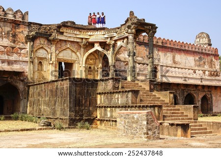 MANDU, INDIA - JANUARY 14, 2012: Indian Schoolgirls near ruins. The Afghan ruined city of Mandu used to be one of the largest and richest cities in India between the 11th and the 15th century.�  - stock photo