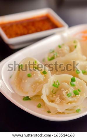 Mandu  , Korean Dumplings , Boiled Pork Gyoza with chili sauce - stock photo