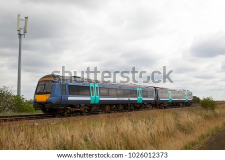 MANEA, UK - APRIL 22: An Abellio operated class 170 DMU heads towards the large midlands city of Peterborough with a stopper commuter service from Ely on April 22, 2015 in Manea