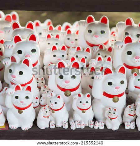 Maneki neko also known as chinese fortune cat - stock photo