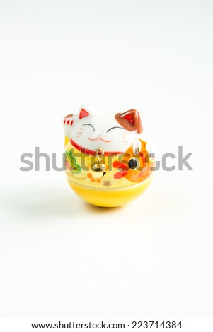 Maneki Neko  Lucky Cat isolated on White Background - stock photo