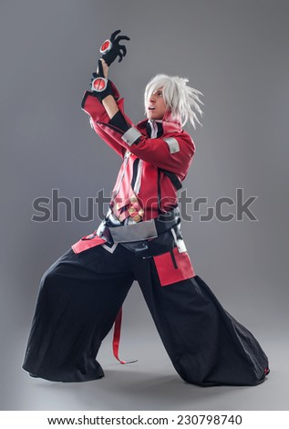 Manga hero with sword. A young man dressed in comic style superhero - stock photo