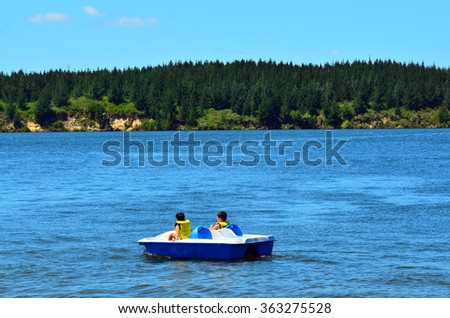 MANGAKINO, NZL - JAN 15 2016:Pedal boat on Lake Maraetai.It's artificial lakes formed as part of a hydroelectricity scheme on the Waikato River in the North Island of New Zealand. - stock photo