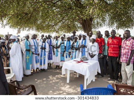 MANGALLA, SOUTH SUDAN-DECEMBER 5, 2010: Unidentified congregants have church under a tree in South Sudan