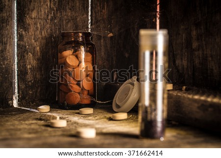 Manganese and tablets in jar on a shelf of old cobwebby.