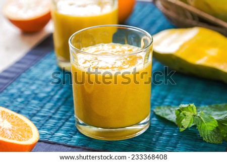 Mango and Orange smoothie by some fresh ingredients - stock photo