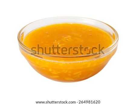Mango Coconut Marinade in a glass bowl. This sauce is ideal for flavoring fish. The image is a cut out, isolated on a white background, with a clipping path. - stock photo