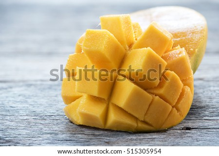 Cut mango stock images royalty free images vectors shutterstock mango cut in cubes pattern on wooden background ccuart Choice Image
