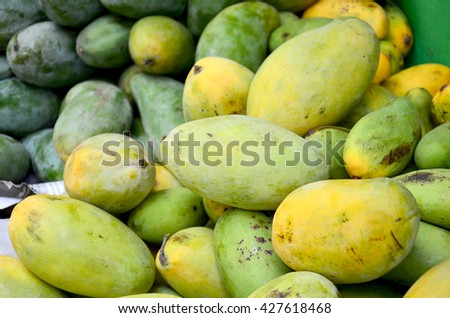Mango fruits at Fruit Shop or greengrocery on street for sale at market in Luang Prabang, Laos - stock photo