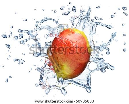 Mango in spray of water. Juicy mango with splash on white background - stock photo