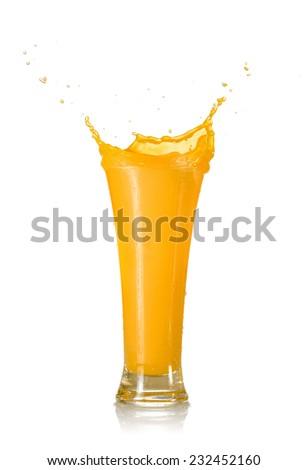 Mango Juice Splash in A Glass Isolated on White Background - stock photo